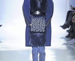 Knits were spotted in Balenciaga's fall 2014 RTW lineup, so check out the cool masculine-inspired collection and see if you spot anything you like!
