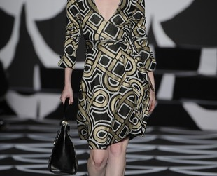 Diane Von Furstenberg celebrated the wrap dress in her fall 2014 collection. Variations of the designer's signature dress style as well as other feminine outfits were spotted on the runway, so check out the complete lineup, next!