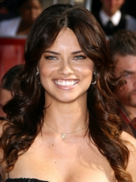 Adriana Lima shows off her beautiful features by pulling her brunette locks back and away from the face, securing it into a bumpy half up hairstyle.