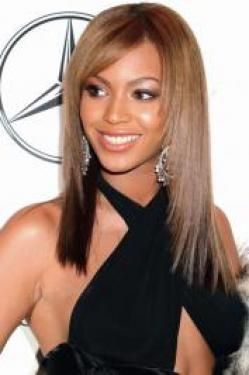 Beyonce made a political fashion statement by flaunting her Obama earrings on her Tumblr on Election Day 2012. She wore her hair pulled up into an undone top knot paired with her [link=http://www.gallery.becomegorgeous.com/beyonce_hairstyles/beyonces_new_layered_hairstyle_with_bangs-6396.html title=Beyonce New Bangs Hairstyle]new bangs[/link]!