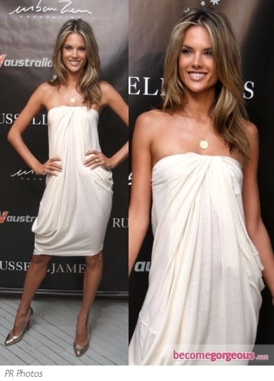 Brazilian supermodel attended amfAR's Inspiration Gala 2012 looking beautiful wearing a black lace gown by Zuhair Murad.