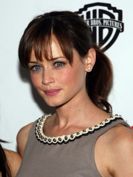Alexis Bledel's gorgeous brunette hair looks elegant and glossy - it;s the perfect sleek bangs and ponytail combination.
