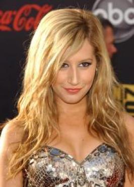 Long, straight hair runs the risk of falling flat, but Ashley Tisdale avoids that fate by adding soft end waves to her style. To style, blow-out hair smooth and wind ends around a curling iron.