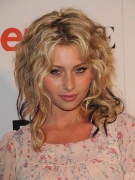 Aly Michalka's naturally curly locks are style for tousled texture. The thin purple highlights down the ends give one shock of color in her blonde hairstyle.