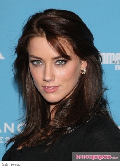 Amber Heard glammed up for the 2011 Hollywood Film Awards Gala with side-swept locks and sultry makeup. Her red carpet hairstyle features a strong, asymmetric part that extends from her forehead to the back, while the crown added a hint of volume. Locks were then flung across one shoulder.
