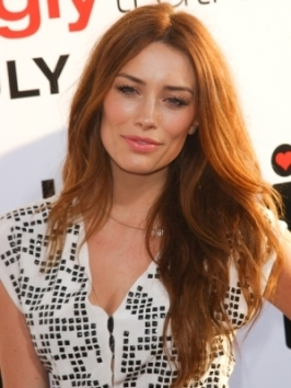 Arielle Vandenberg opts for long red locks with just a touch of texture in the length.