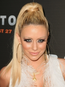 Aubrey O'Day works the side-swiped look at a Hollywood party. Long locks styled from a deep side part and swept over one shoulder up the interest in long, textured locks.