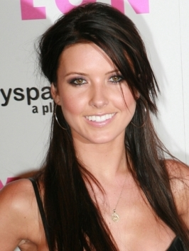 Audrina Patridge prettied up her long locks with shiny curls that she pulled into a low side ponytail. On the opposite side, a French braid gives the look an eye-catching detail.
