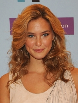 Model Bar Refaeli took Paris Couture Fashion Week by storm with her blonde locks blown-out for a sexy hairstyle. Generous lift at the roots, touchable texture and super-shiny finish make her hairdo a winner.