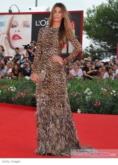 Selma Blair poses on the red carpet during the 2011 Venice Film Festival wearing a gorgeous Lanvin red silk-crepe gown from the Fall 2011 collection.