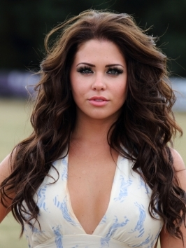 Bianca Gascoigne's thick brunette locks are lush, feminine and sexy when styled with length, wavy layers. Locks are wrapped around a vertically held large-barrel curling iron to create the sultry waves, then hair is directed away from the face and flung across the shoulders.