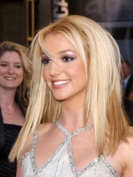 Britney Spears was wearing a long layered, center parted hairstyle back in 2001. Her classic, straight hairstyle is simple - just flat-iron all over to polish the surface.