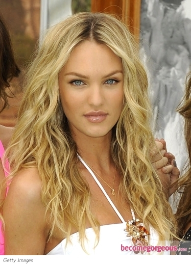 Candice Swanepoel stole the spotlight with her charming looks at the 2012 CFDA Fashion Awards. She wore her golden blonde locks styled with thick milkmaid braids at the top and cascading curls down the back.