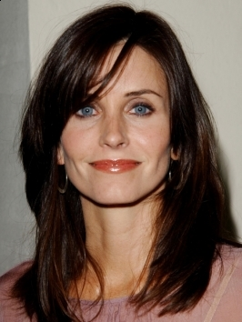 Courtney Cox wears her raven black locks styled with loose, shiny curls that ooze laid-back sophistication. To copy, blow hair out smooth then wrap 2-inch sections around a medium barrel curling iron.