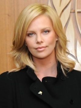 Charlize Theron hit up the 2012 MTV Movie Awards with her signature blonde locks styled smooth from a side part.