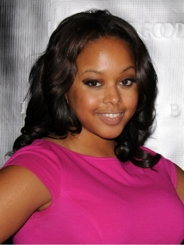Get Chrisette Michele's soft, glam, by blow-drying hair smooth and winding strands around a wide barrel iron. Follow by gently brushing through the loose curls.