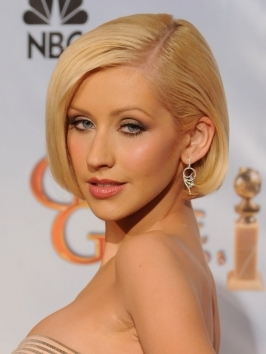 Christina Aguilera debuts a brand new haircut at the 2012 American Music Awards. She rocks her collar bone length bob hairstyle matched with temple to temple bangs in a platinum blonde shade.