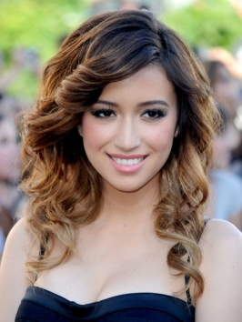"Christian Serratos' retro curls were a blast from the silver screen past which she wore to the LA premiere of  ""The Twilight Saga: Breaking Dawn Part 1"". Get the beautiful swirls with a set of hot rollers."