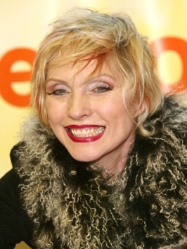 Debbie Harry's fine and thin hair looks great when cut in a short bob with soft bangs - excellent for camouflaging a wrinkled or high forehead.