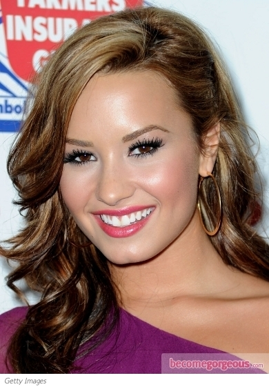 Demi Lovato added a pop of color with a peachy coral lip on her latest red carpet appearance. The lip shade is a great match to her newly dyed red locks and lifts her warm complexion instantly.
