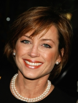 Dorothy Hamill's shine, sleekness and rich color make a winning combination. Sharply tapered all around, her bob hairstyle has elements of softness, including whispy bangs.