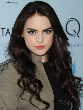 Elizabeth Gillies' sculpted, loose waves are always a stylish option. To copy this look, wrap sections around a large barrel curling iron then brush them out once cool. As a finishing touch, pull twists over the shoulder and define ends with bits of pomade.