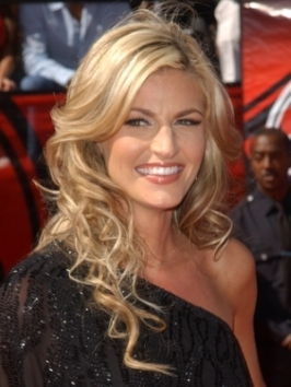 Lifted layers are a smart way to add a little oomph to long hairstyles. Erin Andrews styles her long layers tresses with a hint of volume at the roots and movement at the ends.