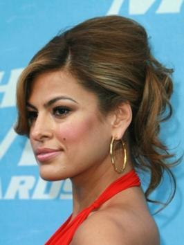 Eva Mendes wore a glam high pony that practically demands all the attention. Her high pony is super tight, showing off her great bone structure and giving her an instant facelift. Eva's ponytail is glammed up with a rhinestone ponytail holder, the perfect finishing touch for a red carpet appearance.
