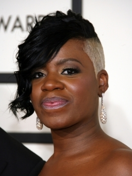 "Fantasia gets her weave on and rocks extra long locks with shiny waves to the ""American Idol"" Season 11 Grand Finale show."