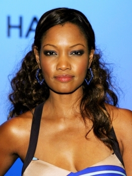Gorgeous actress Garcelle Beauvais worked her thick dark tresses into lengthy tousled waves that are lush and feminine. Hair was styled with a hint of volume at the roots and end are given texture with loose waves.