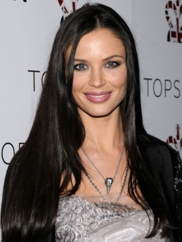 Georgina Chapman goes the ultra straight route. Hair's surface was polished for maximum effect by flat-ironing all over.