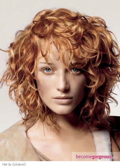 This radiant ginger curly hair style will create a statement impression