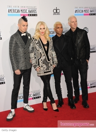 Christina Aguilera showed off her curvy figure on the 2012 AMAs red carpet in a Pamella Roland ombre dress.  A sparkly clutch and Jimmy Choo Sugar pee-toe pumps finish off her look.