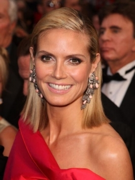 "Heidi Klum debuted her new signature fragrance ""Shine"" looking pretty with tousled shoulder-length locks. If you've got natural texture, work a similar look by diffuse-drying and spiral-wrapping sections around a curling iron. Tousle ringlets in random directions for a natural finish."