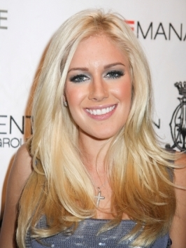 Heidi Montag sticks to the Barbie look, wearing her long blonde hair layered and styled with loose waves to host an evening at the Pure Nightclub at Caesars Palace, Las Vegas.