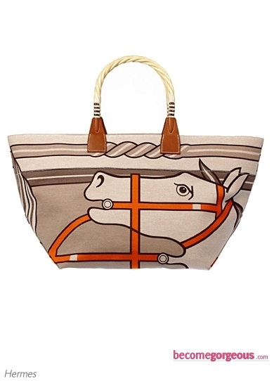 The Hermes 'Kelly' Picnic Bag is the actual jewelry piece of the complete SS 2011 collection. Take a closer look at the fabulous color selection teamed up with the basket style. Inject a country chic influence into your new season wardrobe with a similar ultra-stylish accessory.