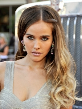 Actress Isabel Lucas hit the Calvin Klein Fall 2010 fashion show with a textured, bedhead 'do. Create similar messy waves by working texturizer throughout damp hair and tousle-drying hair.