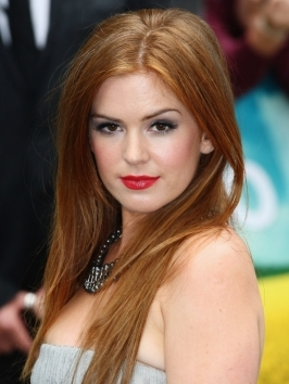 Isla Fisher's long auburn red hairstyle - her trademark hair color - look glossy and glamorous when styled for an extra-sleek finish.