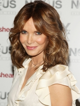 Original Charlie's Angel Jaclyn Smith's glossy brunette curls showcase a great color contrast: the smooth crown and underlayers are a natural dark shade, while curly pieces are warmed up with golden brunette highlights.
