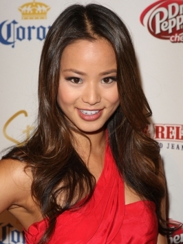 Jamie Chung decided to go a few shades lighter and switched her shade to a warm golden brown color. She wears her long hair styled with thick-bodied, loose waves.