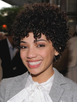 Actress Jasika Nicole embraces her natural texture choosing a haircut that creates a round frame of tight curls around the face.