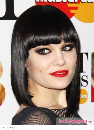 Jessie J gives her locks a stylish update with dip dyed/ ombre blonde ends and a super sleek surface. Glossifier has been worked over the surface to up the shine factor.