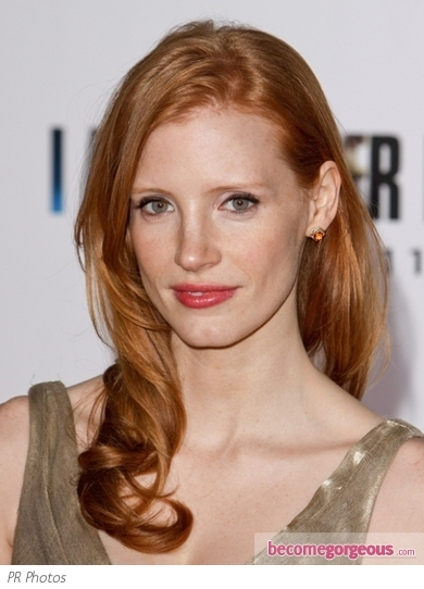 Actress Jessica Chastain wore her red locks waved and loose, with lift at the crown and pieces pinned back, for a highly textured, sexy half up style.