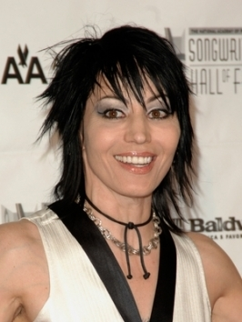 "Joan Jett attended the ""Runaways"" premiere after party wearing her signature rock chick hairstyle - razor cut layers, styled effortlessly for a piecey effect."