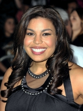 Jordin Sparks works with her natural wavy texture and pinned back top and front sections for a flirty half back hairstyle.