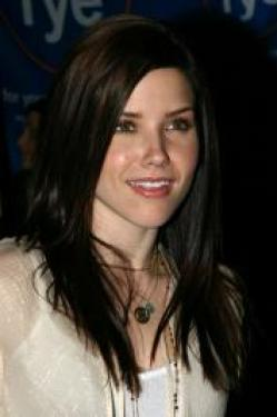 Smooth, sculpted waves make Sophia Bush's locks absolutely eye catching. The smooth as silk finish up top falls into loose, voluminous waves that frame the her face beautifully.