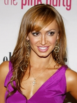 Karina Smirnoff looks girly glam with her loose, flowing waves that she swept over to one side. To do, work through hair with texturizer and direct locks to one side.