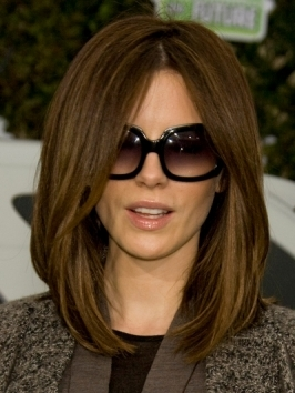 Kate Beckinsale embraces the season's big hair trend with a voluminous ponytail at the 2012 MTV Movie Awards. To copy, blow-dry hair with lots of root lift and pull into a high ponytail.