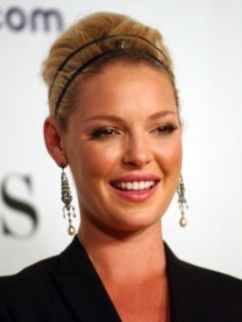 A wavy neck-length bob with an off-center part is a timeless look for Katherine Heigl. To copy her wavy texture, apply volumizer at the root and blow-dry with a round brush, then wrap small sections around a curling iron and finish with hairspray.