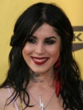 At the opening of her art gallery, Kat von D showed off her new jet black hair color. Her hair falls from a middle part, draping her face with loose end curls.